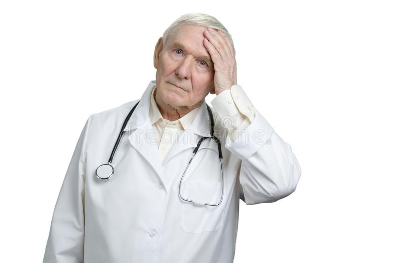 老医生感到抱歉,关于差错的遗憾 免版税库存图片