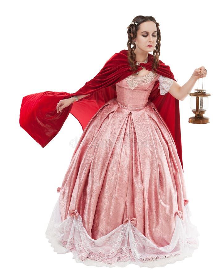 老历史的中世纪礼服的美丽的妇女有灯笼的 免版税库存图片