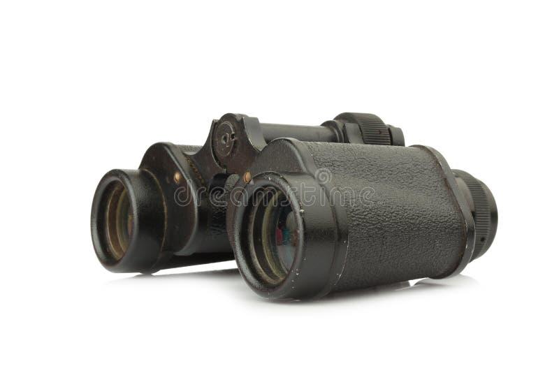 老双筒望远镜 坏 背景查出的白色 库存照片
