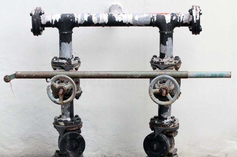 老和生锈的水管 库存图片