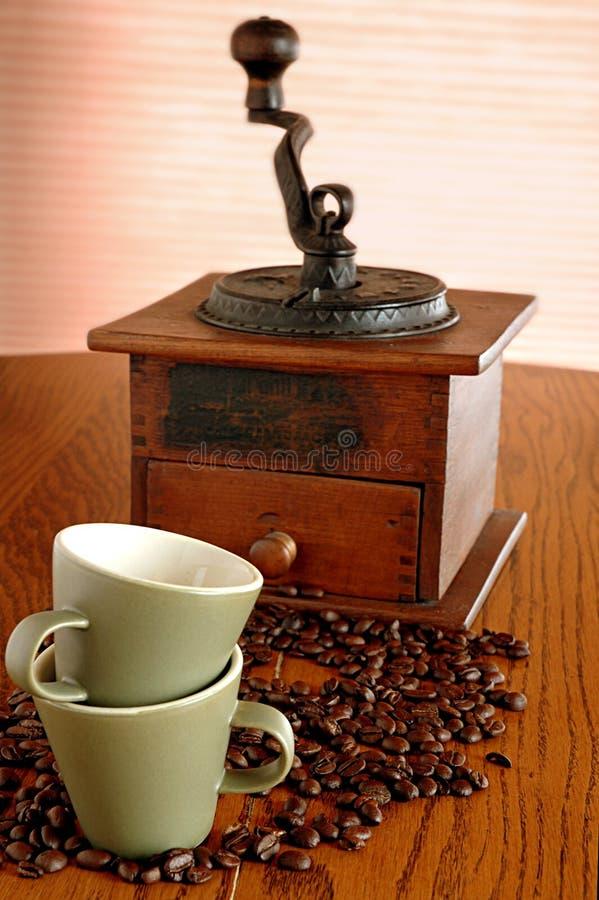 老咖啡杯研磨机 库存照片