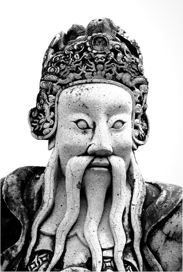 老在公开佛教寺庙的葡萄酒中国战士雕象在 免版税库存图片