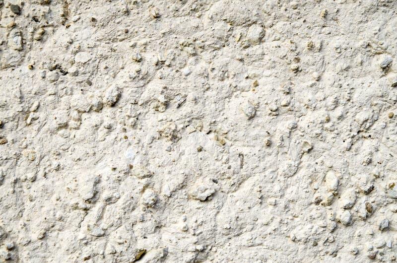 老墙壁涂灰泥与白色绘了泥特写镜头 库存照片