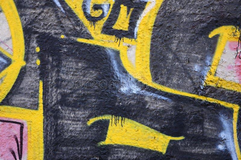 老墙壁的片段有五颜六色的街道画绘画的 库存图片