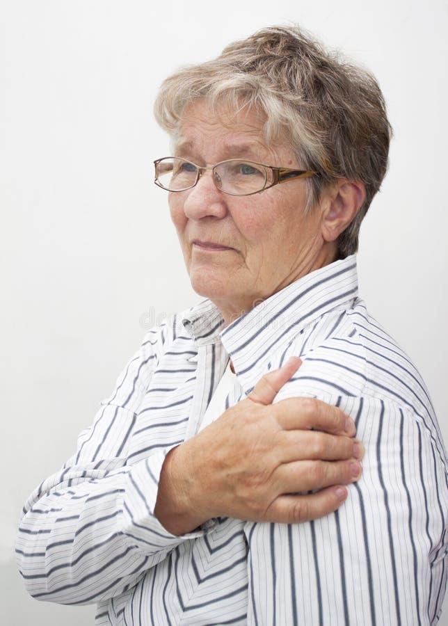 老妇人在痛苦中 图库摄影