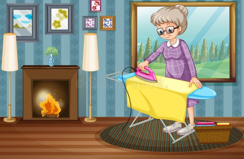 老妇人电烙的衣裳在房子里 库存例证