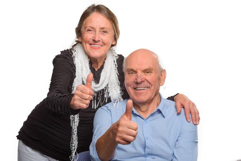 老婆婆和祖父展示OK 图库摄影