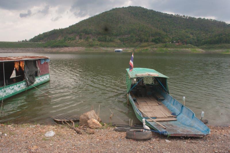 老小船在下雨以后的泰国 免版税库存图片