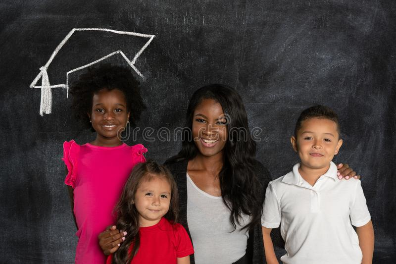 老师和她的学生 库存照片
