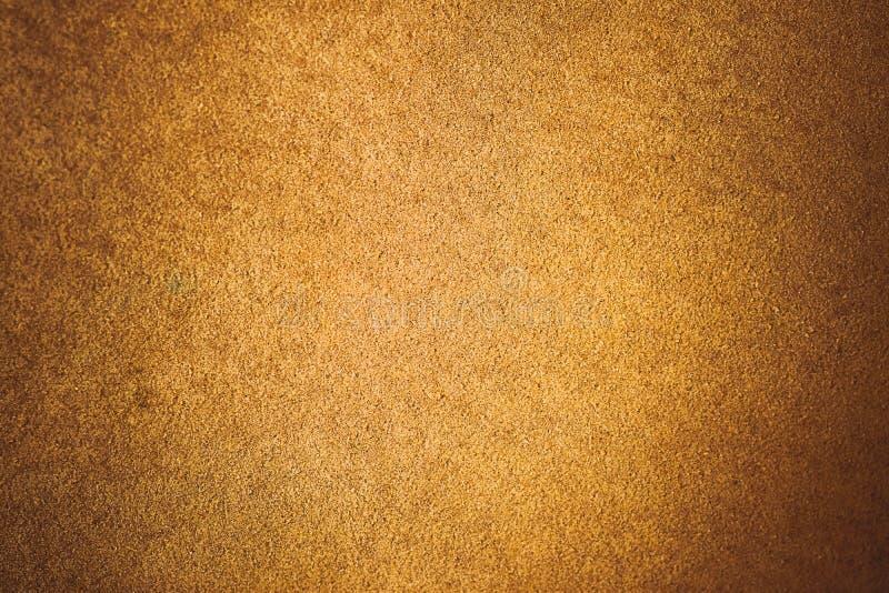 老年迈的绒面革皮革背景 粗糙的纹理,梯度黄褐色米黄,生动的颜色 库存图片