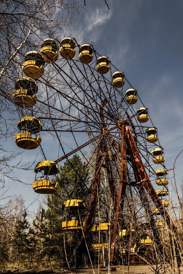 老弗累斯大转轮Pripyat鬼城  事故的后果在Chernobil核电站的 库存图片