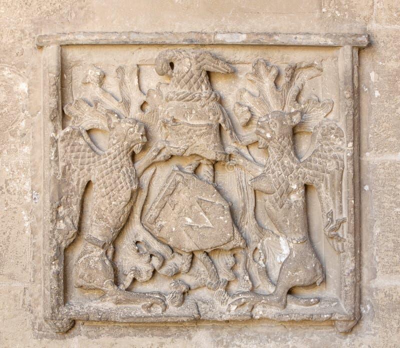 老徽章在墙壁上的在贝济耶大教堂里  库存图片