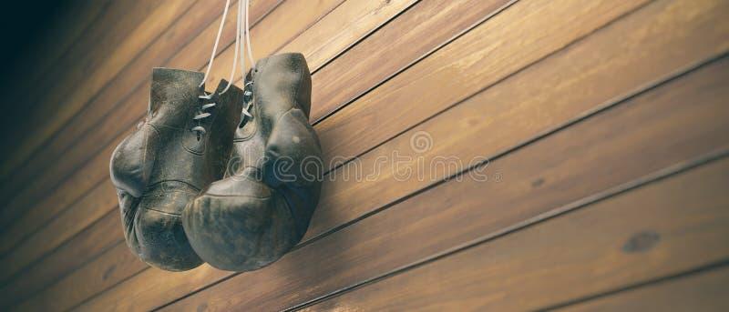 老拳击手套在木墙壁上的钉子垂悬有文本的拷贝空间的 高分辨率3D回报 库存图片