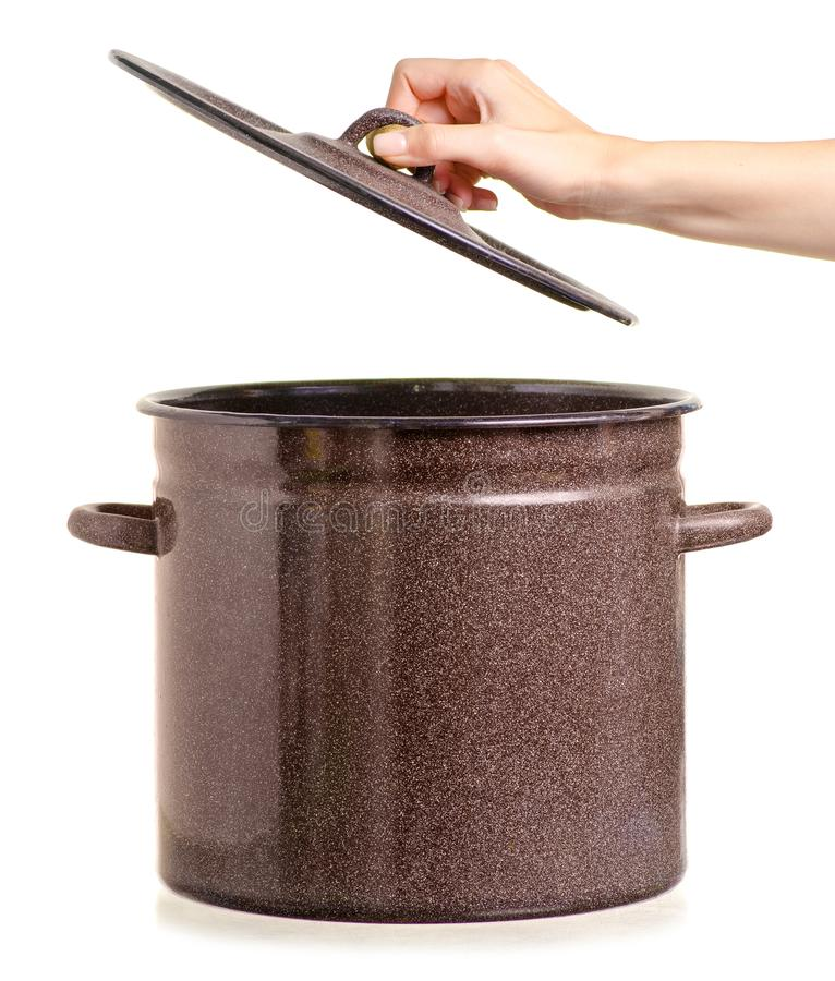 老搪瓷平底深锅在手中 库存照片