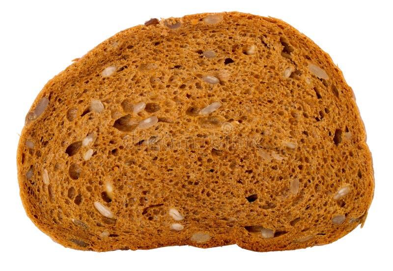 老斯拉夫语面包大块与向日葵种子的在一白色backgr 免版税图库摄影