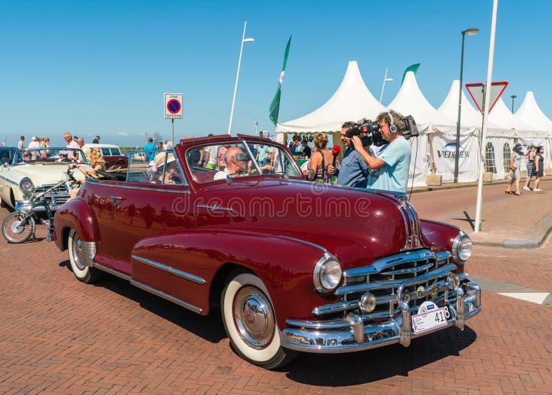 老朋友司机由一个摄象组采访每年全国老朋友天在莱利斯塔德 图库摄影