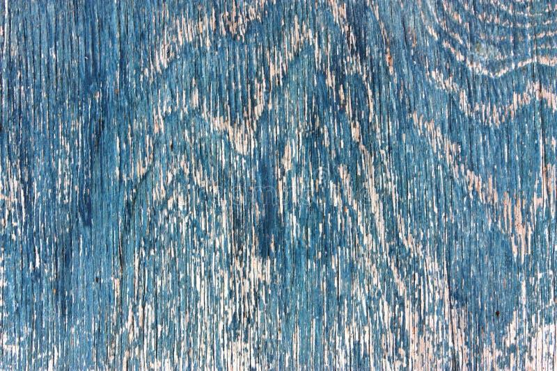 老木板条纹理,破旧的退色的被风化的表面树构造了蓝色油漆以镇压和抓痕,古老木板, a 免版税库存照片