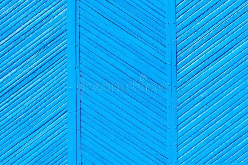 老木破旧的篱芭蓝色颜色,背景 免版税库存照片