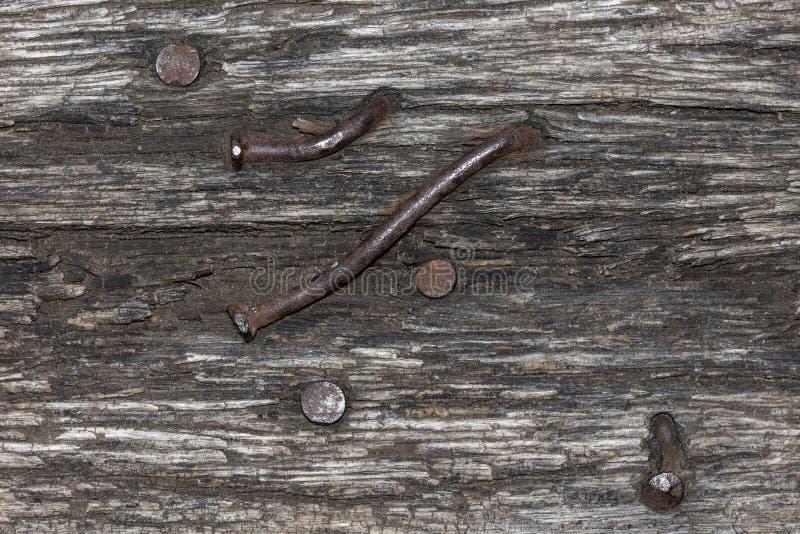 老木头镶边纹理与生锈的钉子的 免版税库存照片