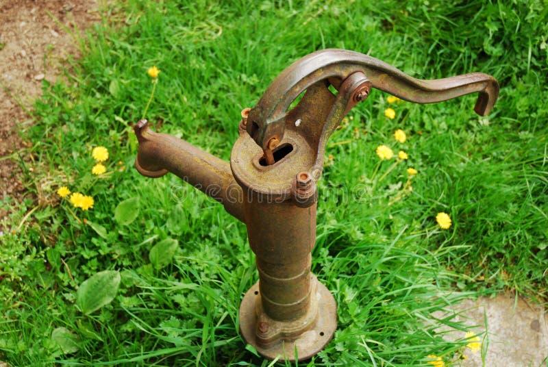 老泵生锈的水 免版税库存图片
