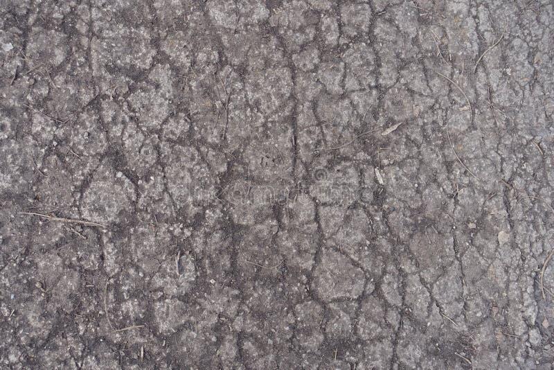 老混凝土路有裂痕的表面  库存图片