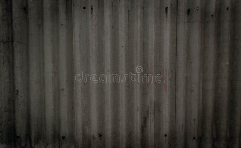老灰色混凝土墙纹理有缝制的handprints和螺栓的 r o 图库摄影