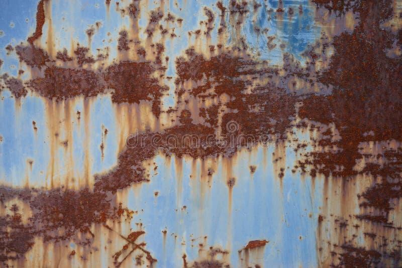 老生锈的被绘的表面,抽象葡萄酒蓝色背景 库存照片
