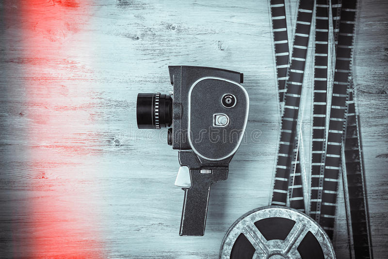 老电影摄影机和影片 免版税库存照片