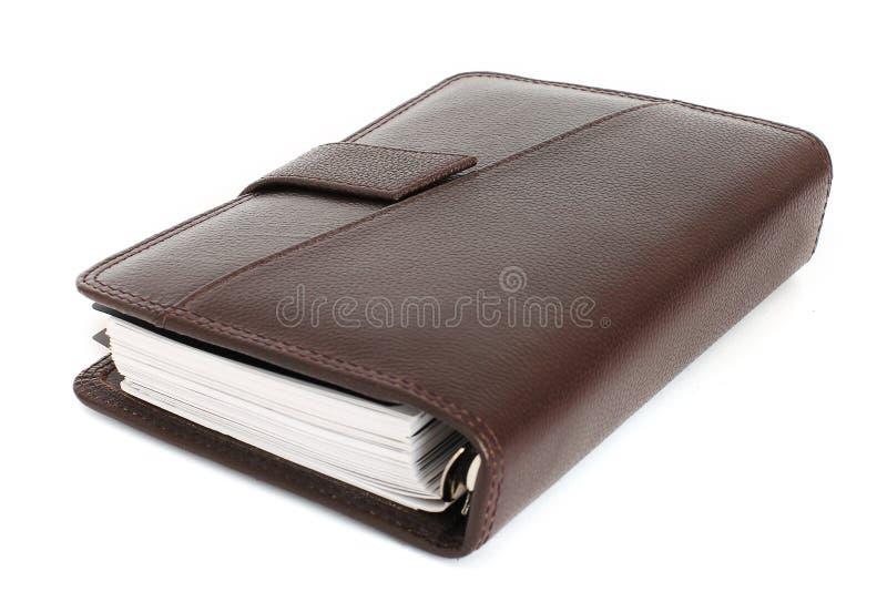 老皮革笔记本 减速火箭的样式 免版税库存照片