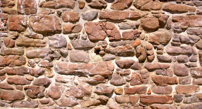 老石头和灰浆墙壁 库存图片