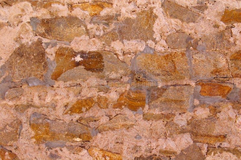 老石头和灰浆墙壁 库存照片