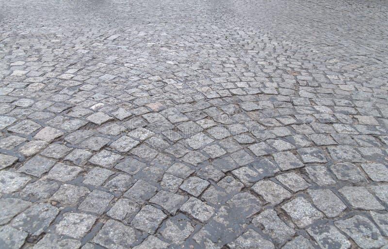 老石建筑coblestone表面岩石背景 图库摄影
