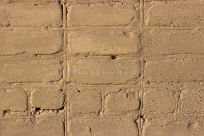 老砖砌绘了米黄 特写镜头 免版税库存照片