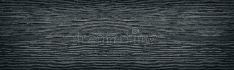 老破裂的黑被绘的坚实木表面宽纹理 黑暗的木全景减速火箭的背景 免版税库存照片