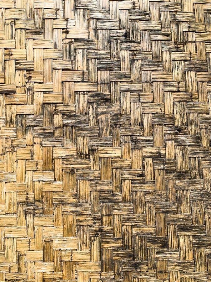 老竹子编织墙壁背景 库存照片
