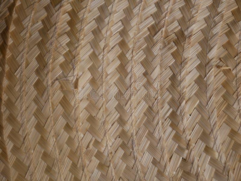 老竹编织的样式,背景的被编织的藤条席子纹理 库存照片