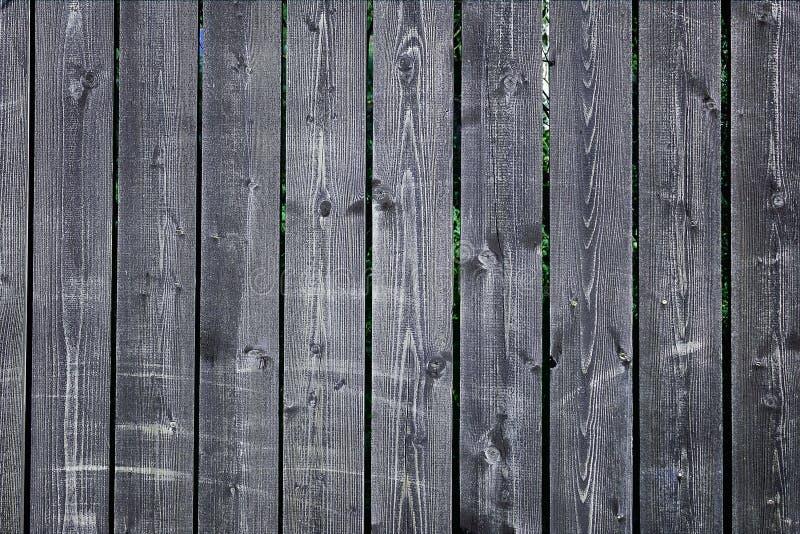 老篱芭的纹理由深灰委员会做成 被佩带的表面木 免版税图库摄影