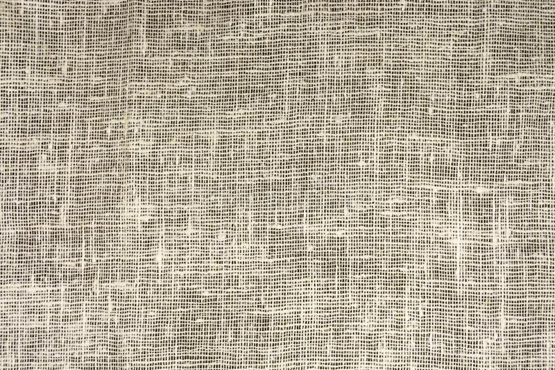 老粗麻布,织品的密集的纹理由胡麻制成 免版税库存照片
