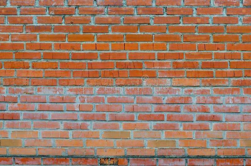老红砖墙壁表面纹理与水泥和混凝土缝的 免版税库存图片