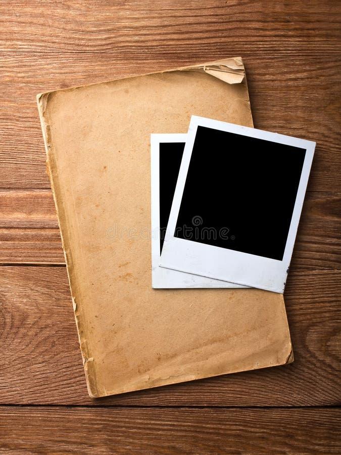 老纸张和照片框架 库存图片