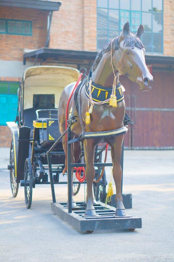 老美丽的儿童车在老镇 库存照片