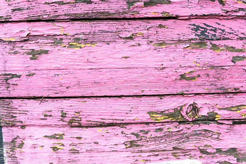 老肮脏的木表面上的油漆蓝色和黄色颜色 免版税库存图片