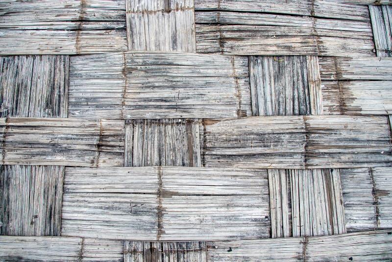 老背景竹子 竹藤条纹理和背景 背景的被编织的竹纹理 库存图片