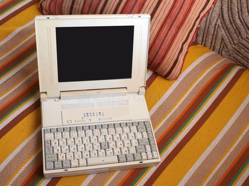 老膝上型计算机 库存照片