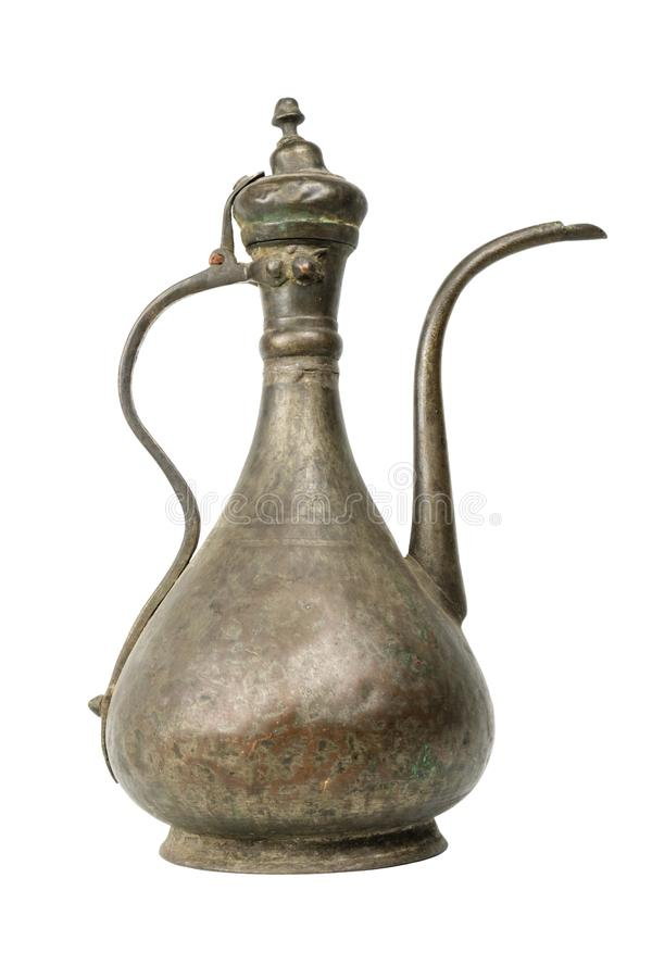 老葡萄酒铜戴头巾水罐 库存图片