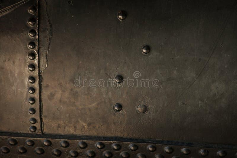老蒸汽机车金属背景  免版税库存图片