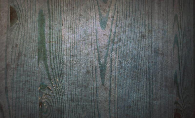 老蓝色弄脏了被抓的木台面厚木板难看的东西样式表面抽象纹理背景 免版税库存照片