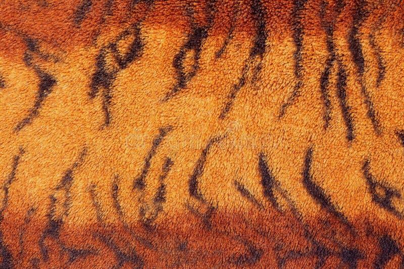 老虎毛皮背景的织品纹理的样式 库存图片
