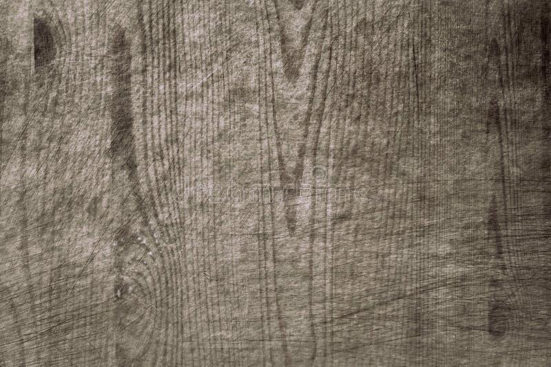 老被弄脏的被抓的木台面厚木板难看的东西样式表面抽象纹理背景 免版税库存照片