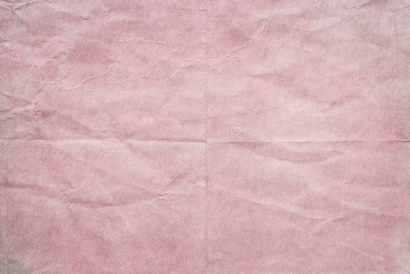 老起皱纹的桃红色纸纹理 免版税库存图片